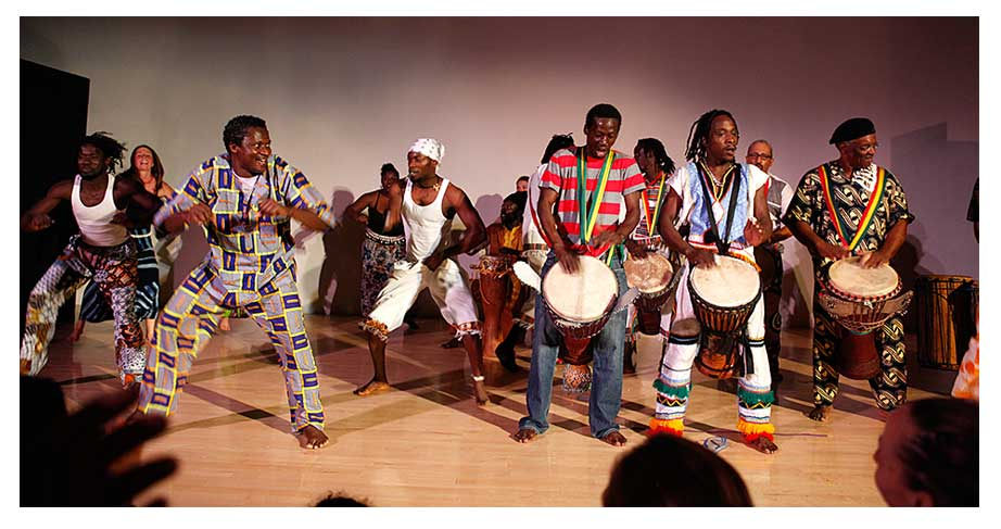 soriba fofana performing with drumming ensemble
